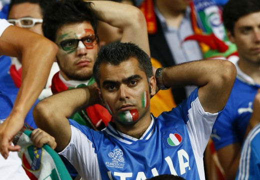 Italian soccer fans react after their team's lost Euro 2012 final soccer match against Spain at the Olympic stadium in Kiev